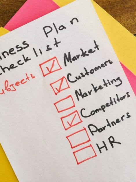 a business plan checklist written on paper